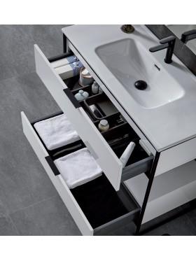 detalle del lavabo y el interior de los cajones